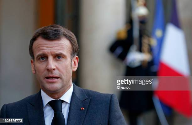 French President Emmanuel Macron makes a statement following his meeting with Head of Libya's Presidential Council, Mohamed al-Menfi and Vice...