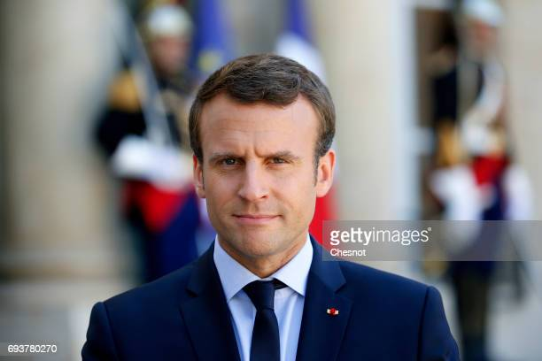 French President Emmanuel Macron makes a statement next to Peruvian President Pedro Pablo Kuczynski during a press conference after their meeting at...
