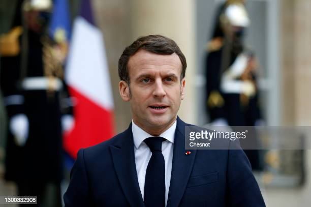 French President Emmanuel Macron makes a statement prior to a working lunch with Moldovan President Maia Sandu during an official visit at the Elysee...