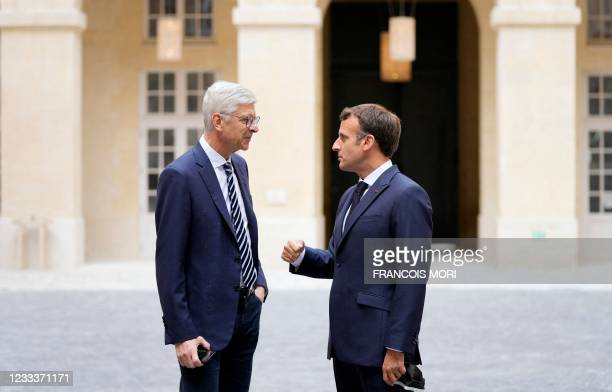 French President Emmanuel Macron meets former Arsenal coach Arsene Wenger during the inauguration of the Hotel de La Marine Museum in Paris, on June...