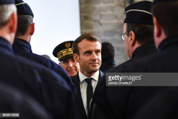 French President Emmanuel Macron meets gendarmerie and police forces during his visit in the French northern city of Calais on January 16 2018 French...