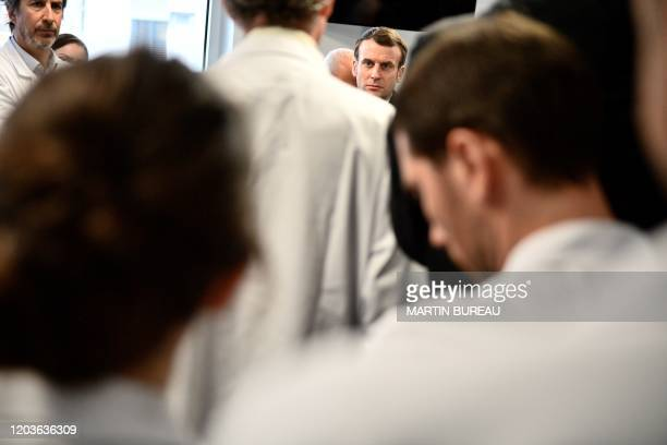 French President Emmanuel Macron meets medical staff as he visits the PitieSalpetriere hospital in Paris on February 27 2020 where the first French...
