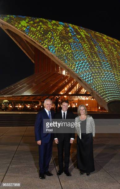French President Emmanuel Macron meets with Australian Prime Minister Malcolm Turnbull and his wife Lucy Turnbull at the Sydney Opera House on May 1...