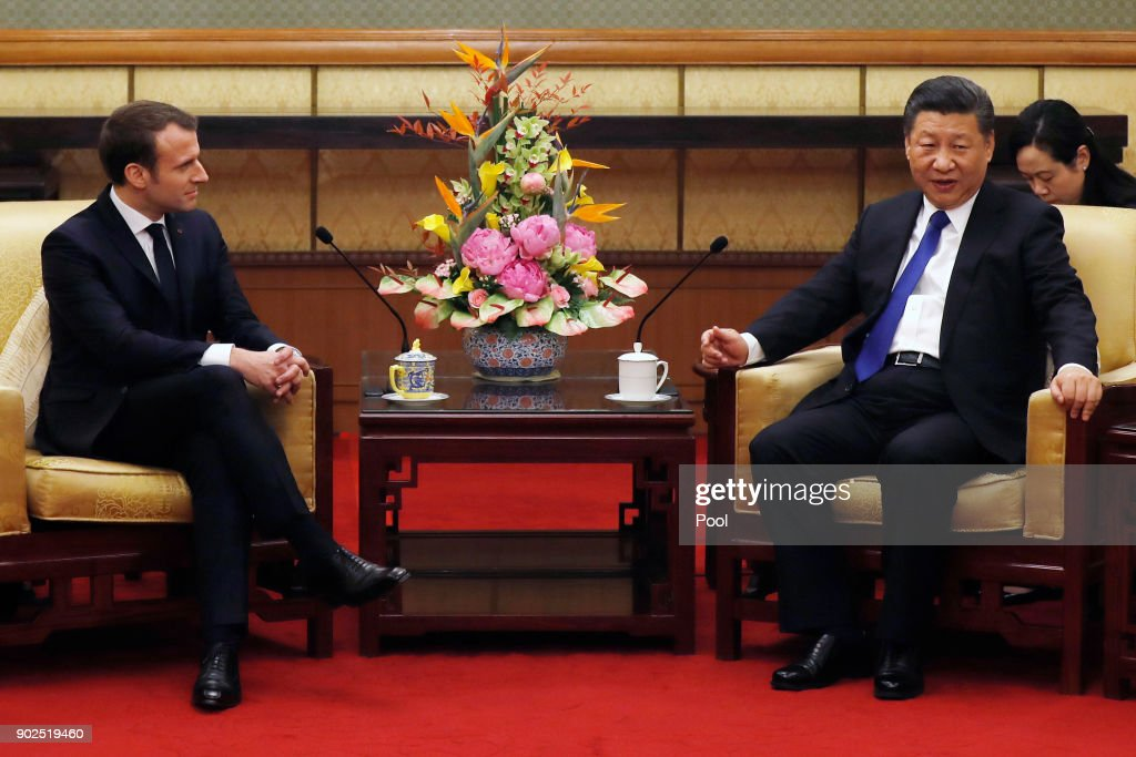 French President Emmanuel Macron (L) meets with Chinese President Xi Jinping (R) at the Diaoyutai State Guesthouse, during his three day state visit on January 8, 2018 in Beijing, China.