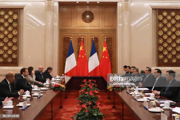 French President Emmanuel Macron meets with Chinese Prime Minister Li Keqiang during their meeting at the Great Hall of the People in Beijing on...