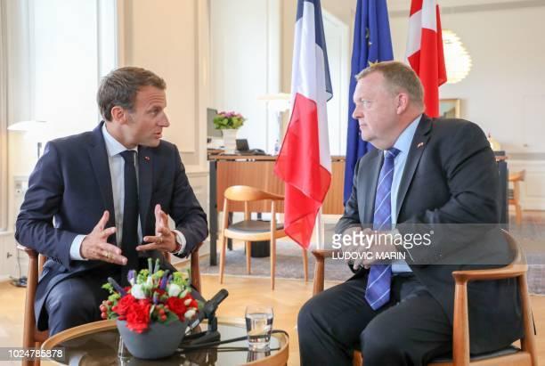 French President Emmanuel Macron meets with Denmark's Prime Minister Lars Lokke Rasmussen on August 28, 2018 at Christiansborg Castle in Copenhagen....