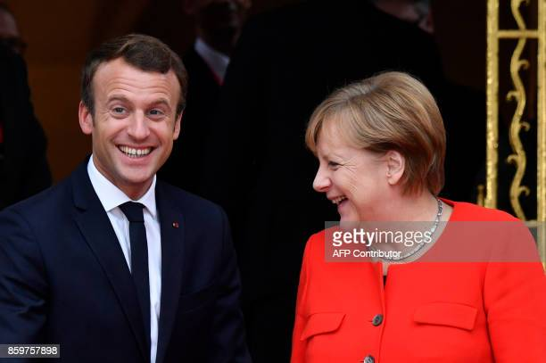 TOPSHOT French President Emmanuel Macron meets with German Chancellor Angela Merkel for bilateral talks before opening the Frankfurt Book Fair on...