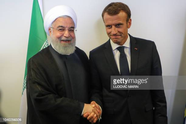 French President Emmanuel Macron meets with Iranian President Hassan Rouhani on the sidelines of the UN General Assembly at the UN headquarters on...