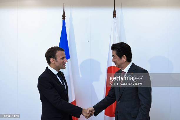 French President Emmanuel Macron meets with Japanese Prime Minister Shinzo Abe on the sidelines of the Saint Petersburg International Economic Forum...