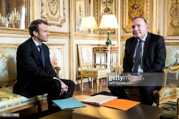 French President Emmanuel Macron meets with the head of the employers federation MEDEF Pierre Gattaz at the Elysee Palace in Paris on October 12 2017...