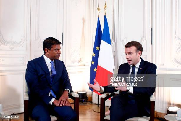French President Emmanuel Macron meets with Vasant Narasimhan Global Head of Drug Development and Chief Medical Officer for Swiss multinational...