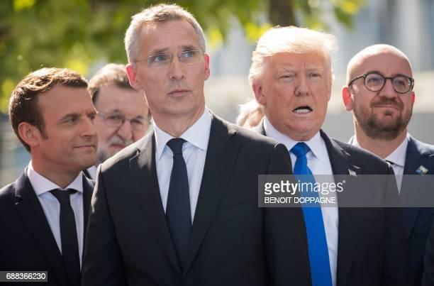 French President Emmanuel Macron NATO Secretary General Jens Stoltenberg US President Donald Trump and Belgian Prime Minister Charles Michel look on...