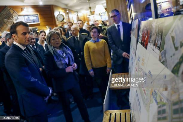 French President Emmanuel Macron next to mayor of Calais Natacha Bouchart looks at a map detailing renovation plans for Calais' seafront in a...