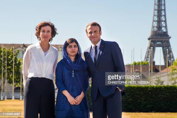 French President Emmanuel Macron Nobel Peace Prize laureate Malala Yousafzai and UNESCO Director-General Audrey Azoulay pose upon arrival at the...