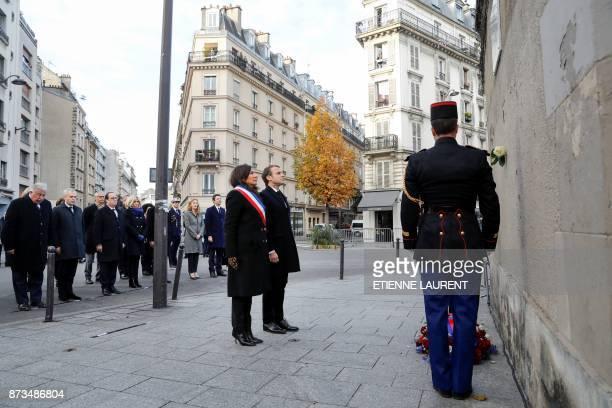 TOPSHOT French President Emmanuel Macron Paris mayor Anne Hidalgo and French Senate speaker Gerard Larcher French National Assembly speaker Francois...