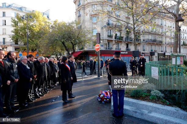 TOPSHOT French President Emmanuel Macron Paris Mayor Anne Hidalgo French Senate speaker Gerard Larcher Paris vicemayor Bruno Julliard and former...