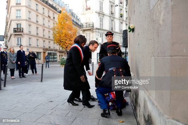 French President Emmanuel Macron Paris mayor Anne Hidalgo lay a wreath in front of a commemorative plaque by the 'Le Carillon' bar and 'Le Petit...