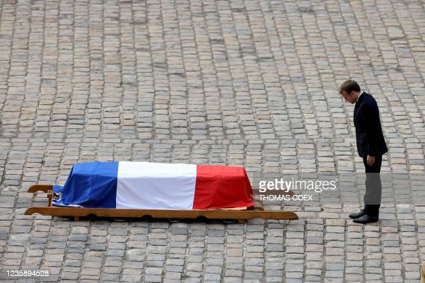 French President Emmanuel Macron pays his respects to the coffin of Hubert Germain during the national memorial service for him - the last surviving...