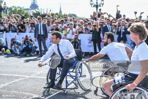 French president Emmanuel Macron playing wheelchair tennis with Michael Jeremiasz during the Olympic Day, Paris Olympic Park comes to life for...