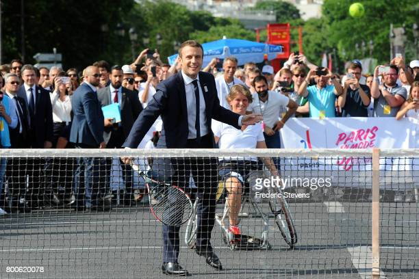 French President Emmanuel Macron plays tennis on Alexandre III bridge as Paris promotes its candidacy for the 2024 Summer Olympic and Paralympic...