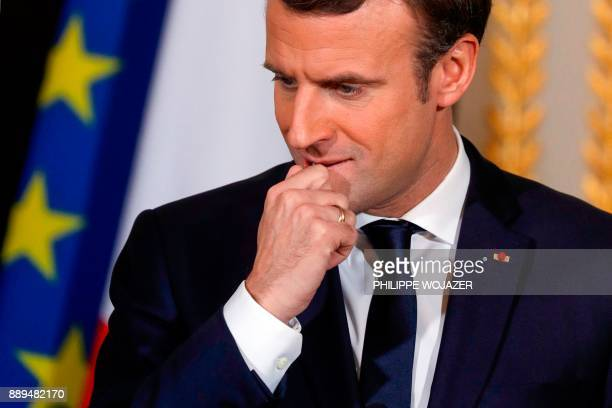 French President Emmanuel Macron ponders during a joint news conference with Israel's prime minister following their meeting at the Elysee Palace in...