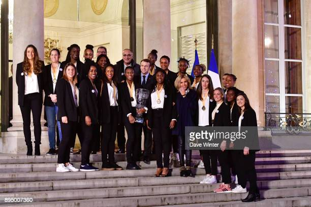 French president Emmanuel Macron pose with the French squad before the reception for the France handball women's team at Elysee Palace on December 18...