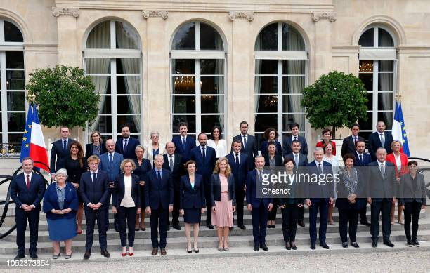 French President Emmanuel Macron poses for a photo with Prime Minister and his government following the weekly cabinet meeting on October 17 2018 in...
