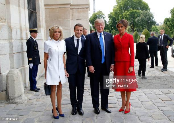 French President Emmanuel Macron poses next to his wife Brigitte Macron US President Donald Trump and Us First Lady Melania Trump outside the Army...