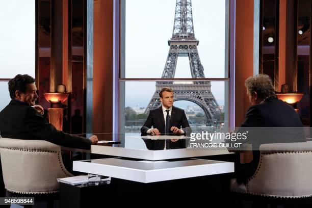 TOPSHOT French President Emmanuel Macron poses on the TV set before an interview with RMCBFM French journalist JeanJacques Bourdin and Mediapart...