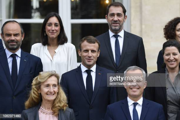 French President Emmanuel Macron poses with cabinet ministers French Prime Minister Edouard Philippe French Junior Minister attached to the Minister...