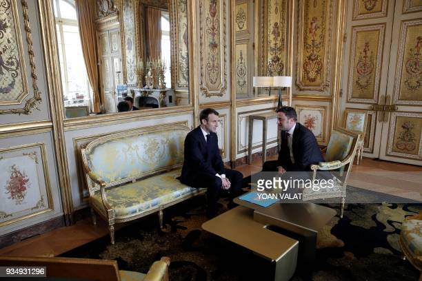 French President Emmanuel Macron poses with Luxembourg's Prime Minister Xavier Bettel prior to a meeting at the Elysee Palace in Paris on March 20...