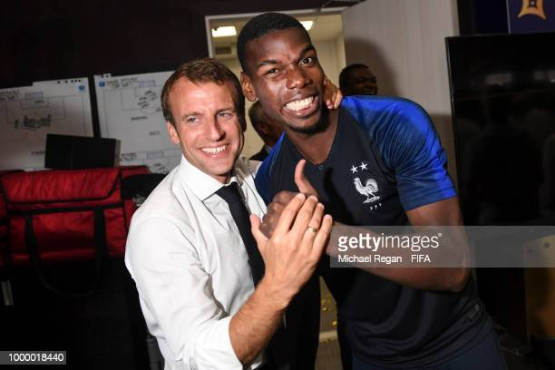 French President Emmanuel Macron poses with Paul Pogba during the 2018 FIFA World Cup Russia Final between France and Croatia at Luzhniki Stadium on...