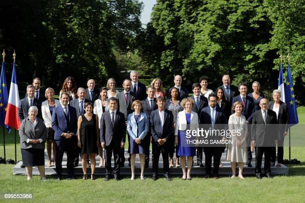 French president Emmanuel Macron poses with the members of the governement French Secretary of State in charge of Ecological and Inclusive Transition...