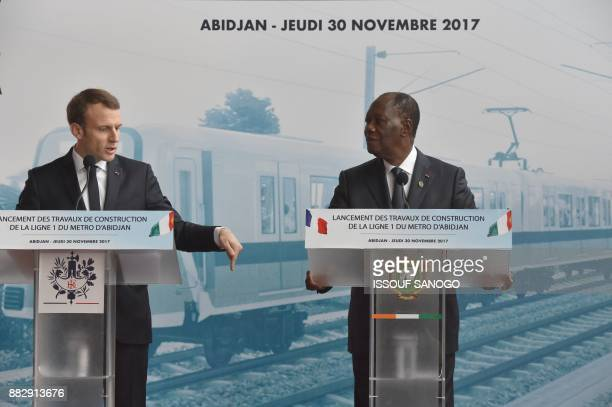 French President Emmanuel Macron president Alassane Ouattara attend a ceremony for the start of the construction of the first metro line in Abidjan...