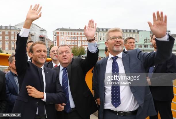 French President Emmanuel Macron, Prime Minister Lars Lokke Rasmussen and Copenhagen Mayor Frank Jensen wave from a river-boat shuttle to Amaliehaven...