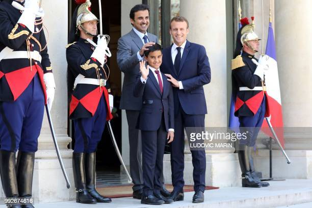 French president Emmanuel Macron Qatar Sheikh Tamim bin Hamad Al Thani and his son Hamad pose upon arrival at the Elysee palace on July 6 in Paris