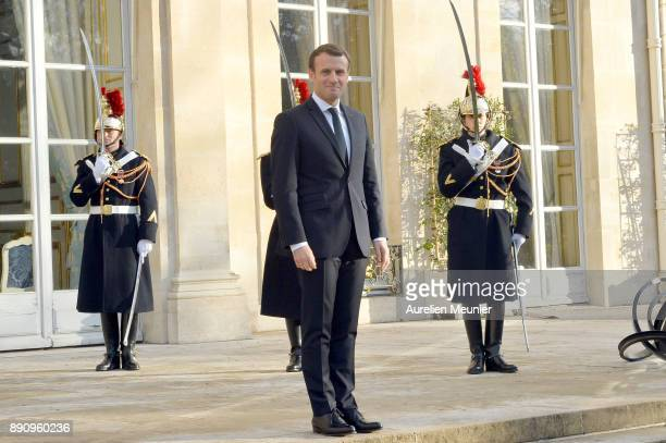 French President Emmanuel Macron reacts as he receives international leaders for a meeting for the One Planet Summit's international leaders at...