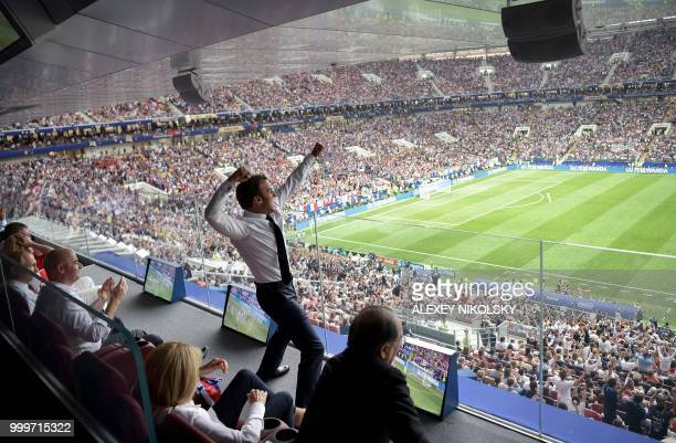 TOPSHOT French President Emmanuel Macron reacts during the Russia 2018 World Cup final football match between France and Croatia at the Luzhniki...