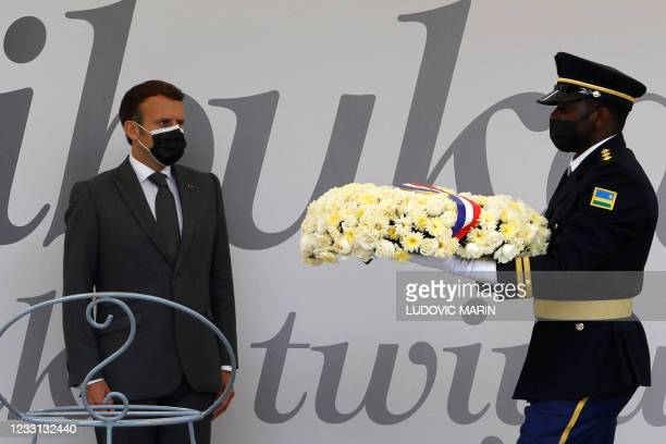 French President Emmanuel Macron readies to lay a wreath in front of 'Kwibuka 27' or remember-unite-renew which marks the 27th anniversary of the...