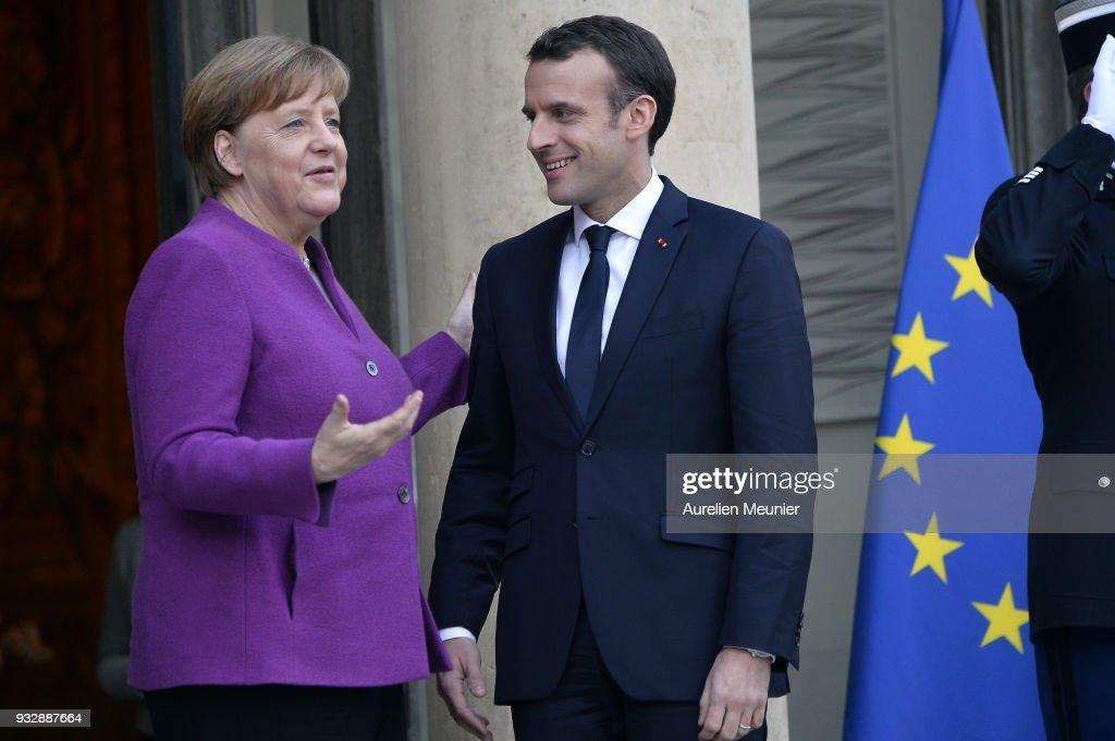 French President Emmanuel Macron Receives German Chancellor Angela Merkel At Elysee Palace in Paris : News Photo
