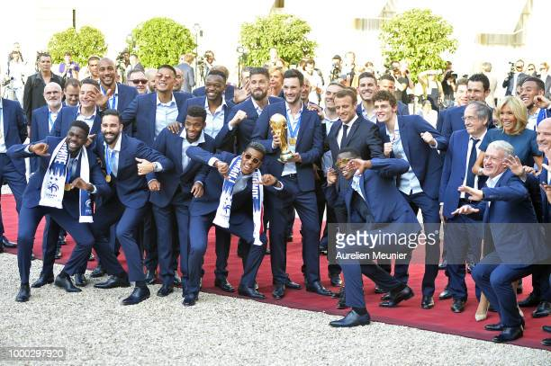 French President Emmanuel Macron receives the France football team during a ceremony at the Elysee Palace on July 16 2018 in Paris France France beat...