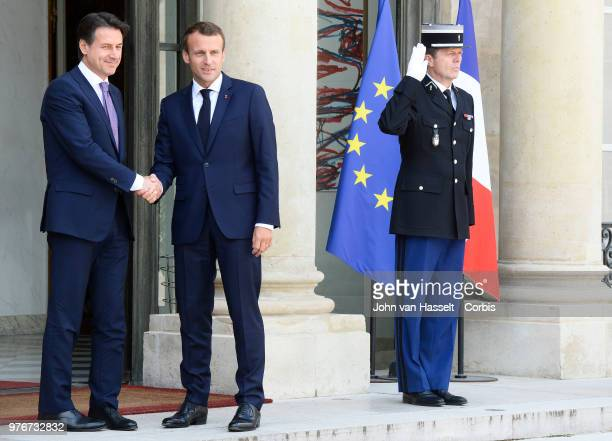 French President Emmanuel Macron receives the new Italian Prime Minister Giuseppe Conte at the Elysee Palace on June 15 2018 in Paris France The...