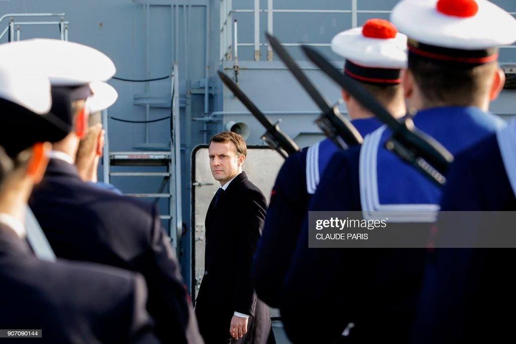 French President Emmanuel Macron reviews French Navy personel as he arrives aboard the French Mistral Class assault ship and helicopter carrier 'Dixmude' to attend a ceremony to present his wishes to the armed forces at the Toulon Naval Base in Toulon, southern France, on January 19, 2018.