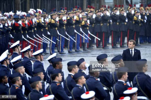 French President Emmanuel Macron reviews the troops during the Commemoration of Armistice Day ceremony on November 11, 2017 in Paris, France. The...
