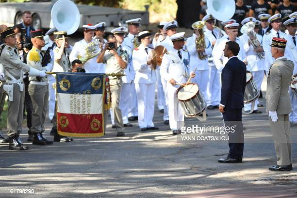 French President Emmanuel Macron reviews troops as he arrives to attend a ceremony marking the 75th anniversary of the Allied landings in Provence...