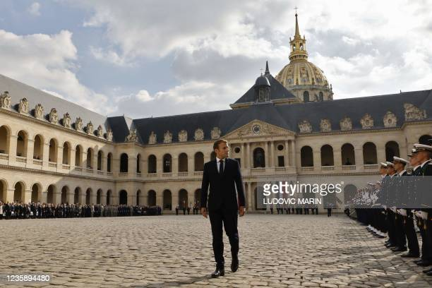 French President Emmanuel Macron reviews troops during a national memorial service for Hubert Germain - the last surviving Liberation companion - at...