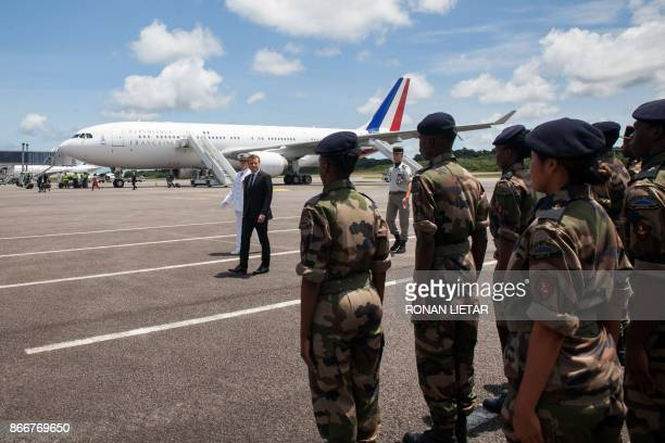 French President Emmanuel Macron reviews troops upon his arrival at the Cayenne FelixEboue airport at the start of a visit in Cayenne French Guiana...