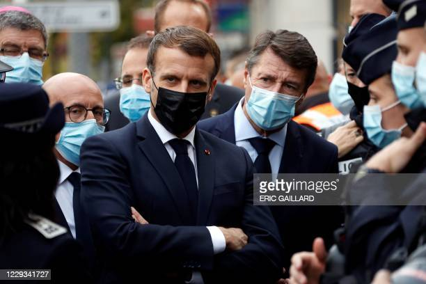 French President Emmanuel Macron , Right-wing party Les Republicains MP Eric Ciotti and Nice Mayor Christian Estrosi visit the scene of a knife...