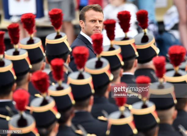 French President Emmanuel Macron salutes troops during the annual Bastille Day military parade in Paris France on July 14 2019