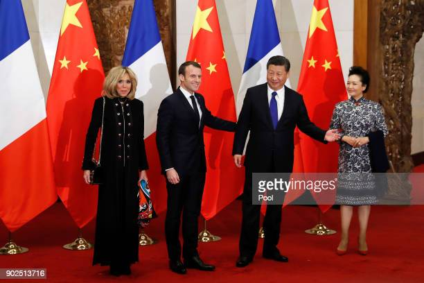 French President Emmanuel Macron second from left and wife Brigitte Macron left meet with Chinese President Xi Jinping second from right and wife...